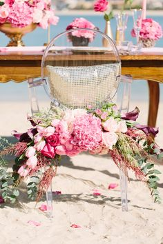 Ghost chair with pink floral garland | Joem Aldea Photography for The Wedding and Event Institute Arabian Campus