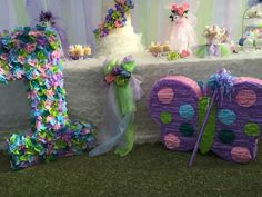 Pretty pinatas at a butterfly birthday party! See more party planning ideas at CatchMyParty.com!