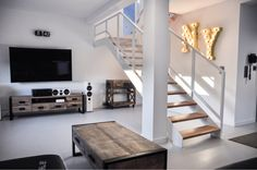 """""""We are passionate about getting to the upper floor. »White matt, loft, mesh,  beech steps www.metaloweschody.pl"""