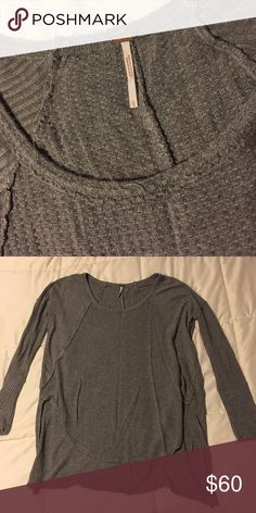 Free people high low sweater Comfiest sweater I've ever owned. Rounded in the front and longer in the back cut at a straight line. Tiny hole in the front but it goes unnoticed by how the top lays. Ask for extra pictures if needed!! Free People Sweaters Crew & Scoop Necks