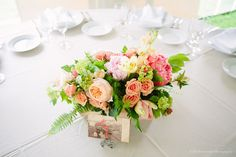 Flower centerpiece for a Spring wedding at Friendly Crossways Retreat Center in Harvard, MA | Kelly Benvenuto Photography