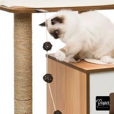 Catit Vesper Base - Modern Scratching and Sleeping Spot - The Vesper Base is the ideal place for your cat to play or nap. The den has two entrances so your cat won't feel cornered. Thanks to the combination of natural scratching surfaces, this piece of furniture is both attractive and sturdy. #cat #kitten #design #furniture #homedecor #interiordesign