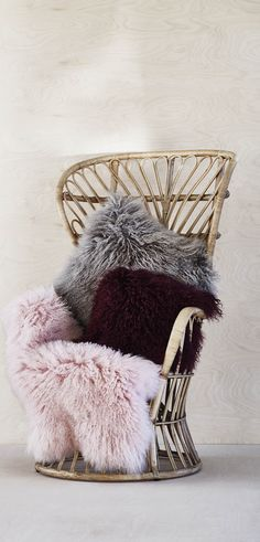 Live luxuriously with the oh-so-snuggly texture of this burgundy Sheepskin Berry Cushion.