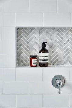White subway tiles frame a gray marble herringbone tiled shower niche.Another niche idea. White subway tiles frame a gray marble herringbone tiled shower niche. Tiny House Bathroom, Laundry In Bathroom, Subway Tile Bathrooms, Bathroom Marble, Bathroom Grey, Accent Tile Bathroom, Turquoise Bathroom, Tile For Small Bathroom, Simple Bathroom