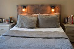http://www.etsy.com/de/listing/155119658/rustic-headboard-with-built-in-lighting
