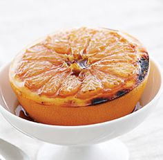 Broiled Grapefruit with Honey, Vanilla, and Cardamom. Also good with a sprinkle of raw sugar and cinnamon instead.