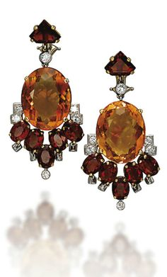 RETRO CITRINE AND DIAMOND JEWELLERY, BY CARTIER set with vari-cut two-toned citrines, enhanced by circular-cut diamond detail and a pavé-set diamond scrolling top, to the rectangular-cut citrine crescent trim, a pair of ear pendants, mounted in platinum and gold, 1950s, earrings 4.5 cm