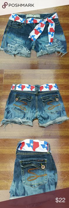 """Seven 7 Denim Distressed Cutoff Jean Shorts 29 Seven 7 Premium Denim distressed style cut off shorts.Dip dye coloring . Great condition. Ribbon Texas """"belt"""" . Styled for 4th of july holiday lake wear!  Tagged size 29.  Measurements : Length 12"""" 3""""Inseam 14"""" across front waist laying flat #ravenkittystyle #seven #7denim #premiumdenim #cutoffs #lake #summer #spring #boat #4thofjuly #redwhiteblue #denim #size29 #distressed Seven7 Shorts Jean Shorts"""