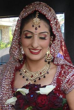Another traditional burgundy Indian bridal look. Love the eyes and lashes. The colour on the lips looks bold and beautiful in the picture. Brides have a choice of using neutral tones or going with deep reds and burgundys. Makeup and Hair and Styling by super talented Vancouver makeup artist Radha Sarn of salonpicasso.ca