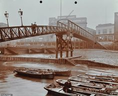 Limehouse Pier, Poplar, London, A bridge leads to the pier looking towards Dundee Wharf and Horn and Chequers Public House with barges resting on the mud and a man sitting in a rowing boat on. Get premium, high resolution news photos at Getty Images London Docklands, Tower Hamlets, East End London, Victorian London, The Blitz, London History, Steampunk, Street House, River Thames