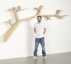 French Designer Olivier Dolle designs the shelves on the wall into branches