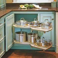 Corner Pull-out Shelf has two height-adjustable peanut-shaped shelves that snake out and to the side in one fluid motion.  Find other savvy kitchen cabinet storage ideas at kitchensource.com | thisoldhouse.com