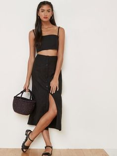 I'm not me without you. This is a two piece set with a cropped top and skirt that hits below the knee.