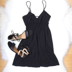 """Black Dress  Black spaghetti strap dress with V front. Basic dress to wear as a nice beach coverup or to a casual event! I am 5'3"""" for length reference and this is 22"""" from armpit to bottom of the dress. Never worn in great condition! Not trades  Forever 21 Dresses Mini"""