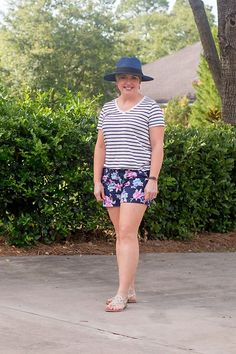 A striped tee pairs well with floral shorts and makes pattern mixing easy. Add a straw hat for a fun accessory. #summeroutfit #cuteoutfit Short Outfits, Summer Outfits, Cute Outfits, Summer Dresses, Outfits With Striped Shirts, Plaid And Leopard, Floppy Straw Hat, Wearing A Hat, Romper Outfit
