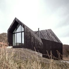 RAW Architecture Workshop have designed this angular black house at Camusdarach Sands with huge windows for taking in the views over the Scottish landscape. The shapes of these expansive gable windows are a play on…