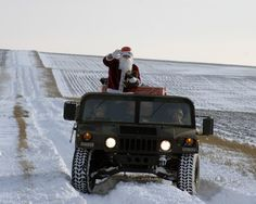 Dressed as Santa Claus, U.S. Army Warrant Officer 1 Eric Christianson, a jumpmaster with the 5th Quartermaster Detachment, 21st Theater Sustainment Command, rides in a Humvee during the detachment's fourth annual Operation Toy Drop Dec. 13, 2012, in Alzey, Germany. During the event, U.S. soldiers, airmen and paratroopers from Germany, Spain, the Netherlands and Poland jumped from a U.S. Air Force C-130 Hercules aircraft to earn foreign jump wings after donating toys to the effort.