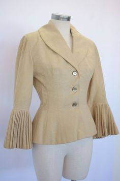 1950   Cream Flecked Wool Peplum Jacket with According Pleated Sleeves by Lilli Ann