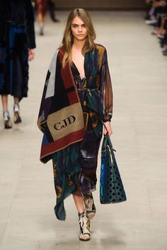 Pin for Later: Get in the Trenches With Burberry's British Invasion Burberry Prorsum Fall 2014 The collection gave rise to the monogrammed poncho street style trend that the models have started to carry out.