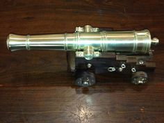 Posts about 1779 Model Naval Cannon written by John Canon, Hand Cannon, Metal Art, Track Lighting, Guns, Miniatures, Ceiling Lights, Brass, Ship