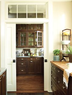 Despite this Senoia, Georgia kitchen's sweet, Southern style, all of the countertops, cabinetry, and hardware are from IKEA. A quartz material called Caesarstone protects not only the top of the kitchen island but also the sides from daily bumps and dings. Wood planks, trim, and support brackets give the IKEA stainless-steel vent hood a built-in cabinet look.
