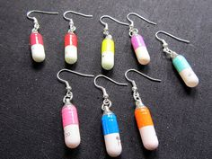 Pills earrings with message secret hideout pill by miniblings, €5.99