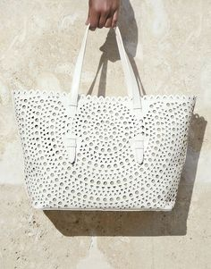 Toting all the beach essentials in this adorable perforated leather bag this summer. Roomy and cute? Yes, please.
