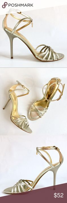"""GUESS By Marciano Gold """"Tina"""" Snakeskin Stiletto GUESS By Marciano Gold """"Tina"""" Snakeskin Stiletto Sandal.   In great shape, other than a few places on the sole where the gold has came off the leather from me wearing them. I can't wear them anymore after have my child, my foot widened a little.  *I would caution to buyers these fit best for narrow feet.   Size: 6  4.5"""" stiletto heel height   Gold hardware with cute dangling GUESS Charms on the front and back heel.   Genuine leather with…"""