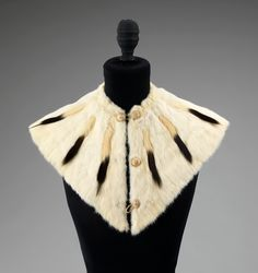 """This ermine tippet cape, circa 1865, would have been used in winter to fill in the low cut necklines of Civil War era evening wear."""