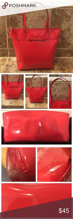 """Kate Spade Red Tote Bag Classic tote shape and color! Great pop of color rotor everyday wardrobe!!  Purse was carried twice during the holidays. In like new condition. Only signs or minimal wear is on the corners, and the bottom where there are two small dark marks. Wear on corner so unnoticeable that I had a hard time capturing in a photo. Smoke free home. Dimensions: W: 11.5"""" H:10.7"""" Top of handles to zipper 6.5"""" W of opening approx 7"""".  Questions just ask! kate spade Bags Totes"""