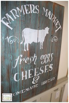 Painting rustic barnwood signs- Farmers Market made by www.EthicalVillage.com. Gorgeous signs!!