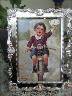 Victorian inpired Valentines Day postcard in silverplated frame (boy on motorcycle with letter)    Available at Heidi's Cottage Country Home Decor and Gift Store, Dunellen, NJ. www.heidiscottage.com