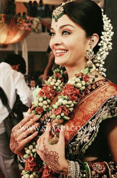 Designer garland in artificial golden hued motifs, shimmery tiny green leaves and intricately crafted mini roses stringed togethger in alternating bunches lends a fashionable look #ShaadiMagazine #Garlands