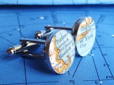 Do men still wear cuff links? Cuff links made from maps.  Grooms men's gifts?
