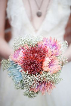 """Fun"" Bridal Bouquet Comprised Of: Red Pin Cushion Protea, Blue Spider Mums, Pink/Purple Spider Mums, White Gypsophila**** Exotic Wedding, Floral Wedding, Wedding Colors, Wedding Styles, Wedding Flowers, Bouquet Bride, Wedding Bouquets, Protea Bouquet, Bouquet Flowers"