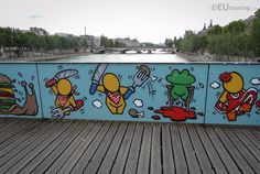 This panel on the Pont des Arts is to restrict love locks being placed, showing an artistic take on the stereotype of French cuisine with its frog legs.  You may be interested in more; www.eutouring.com/images_pont_des_arts_2015.html