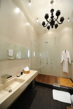 love the teak wood floor in shower and the long deep sink