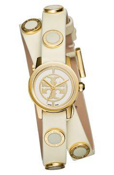 Finishing off the arm-candy with this trendy Tory Burch ivory and gold double-wrap watch.