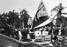 On August 12, 1898, the flag of the Kingdom of Hawaii over ʻIolani Palace was lowered to raise the United States flag to signify annexation.