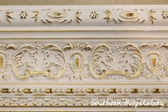 We painted over the gold molding with light pink, Antoinette. After it dried, we rubbed off with a t-shirt and the gold shines through, a simple way to distress.