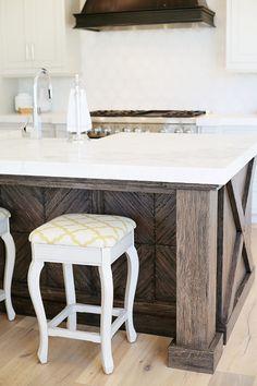 Kitchen Island. Kitchen with quarter sawn distressed oak cabinets. Kitchen Island Design. Kitchen Island Counterstool. Kitchen Island Ideas. #KitchenIsland Millhaven Homes.