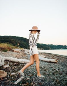 Black and white striped top tucked into white high waisted shorts, baby blue decks and a beige fedora hat! Beach style heaven