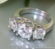 Brillanten Ring mit drei Solitären image