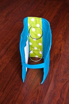 "Quiet Book Cover- ""To make the cover I took this tutorial and tweaked it a little. I basically just wrapped the fabric around a piece of Pellon and sewed it. To bind it, I used 1"" rings and cut 6 holes in the Pellon, 2 for each ring. Then after I sewed the fabric on I used the seam ripper to cut the same hole in the inside fabric."""