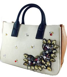 Beige embellished totebag available at Amazon.