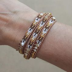 This bracelet features shell and gold integrated with beautifully patterned Miyuki glass seed beads handwoven onto natural leather. Bracelet includes an engraved Katie Joëlle clasp and wraps around th