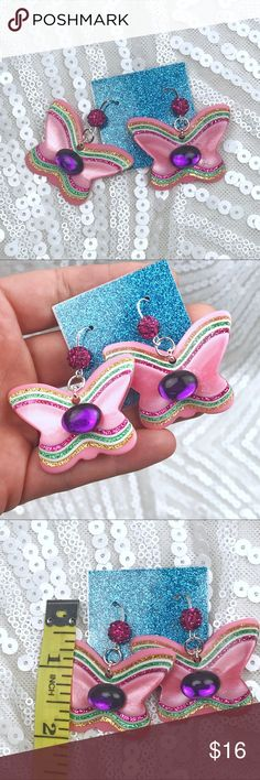 Flutterby rainbow drops Cute little rainbow butterflies in a pearly moonglow acrylic with glitter accents. Topped with a fabulous vintage 80s lucite cabochon and hanging from a silver plated long elegant hook with pave disco ball. Vintage Jewelry Earrings