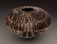"Melanie Ferguson Ceramics ""Pitch Circularity"" 9"" h x 12"" w spiral form, hand-built, with crackle slip, oxide stain, soda fired in heavy reduction"
