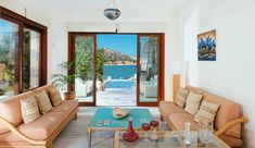 Stone built traditional villa, with modern comforts for up to 8 people. It is beachfront and it is located from Agios Nikolaos cosmopolitan area. Enjoy peace and sea views during your best vacations in Crete. Best Vacations, Crete, Villas, Couch, Traditional, Building, Holiday, Modern, Furniture