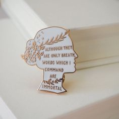 Make your pin game strong with our Sappho enamel pin badge. The perfect literature themed gift for a book lover. Part of our Women Poets collection, this white and rose gold enamel pin takes inspiration from the Ancient Greek poet Sappho. 'Although they are only breath, words which I command are immortal.' - Sappho T